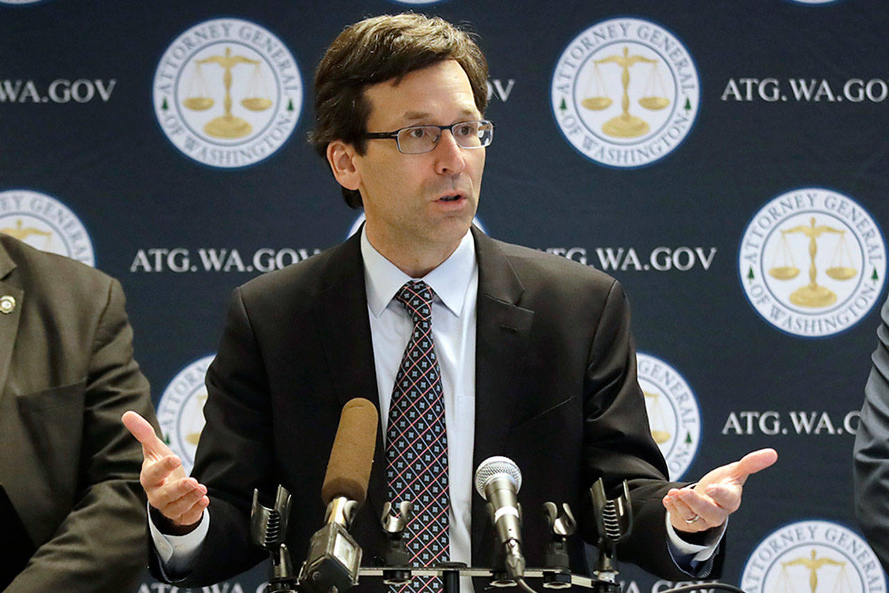 Washington state Attorney General Bob Ferguson speaks during a news conference about Ferguson's lawsuit, challenging a Trump Administration practice of ICE arrests at courthouse, in December, 2019, in Seattle. Washington state sued the Trump administration over its practice of arresting people at courthouses for immigration violations, saying it interferes with the state's authority to run its own judicial system. (Elaine Thompson / Associated Press)
