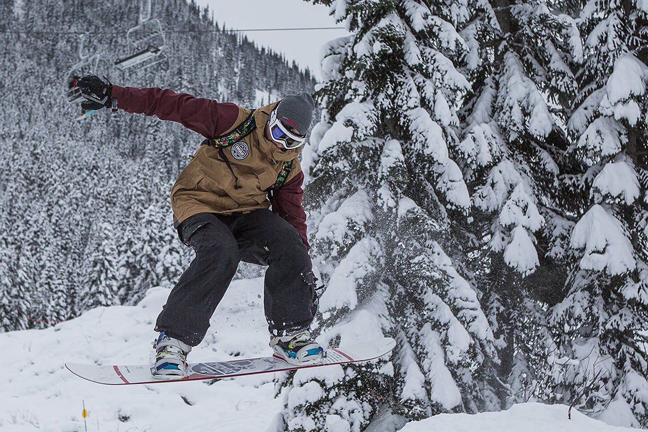 Ryan Leveck makes a jump as he makes his way down the slopes during the opening day of Stevens Pass on Wednesday, Dec. 18, 2019 in Stevens Pass, Wash. (Olivia Vanni / The Herald).