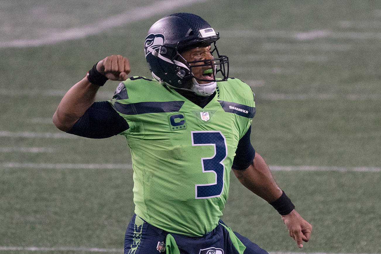 Seattle Seahawks quarterback Russell Wilson reacts after throwing the game winning touchdown during the second half of an NFL football game against the Minnesota Vikings, Sunday, Oct. 11, 2020, in Seattle. The Seahawks won 27-26. (AP Photo/Stephen Brashear)