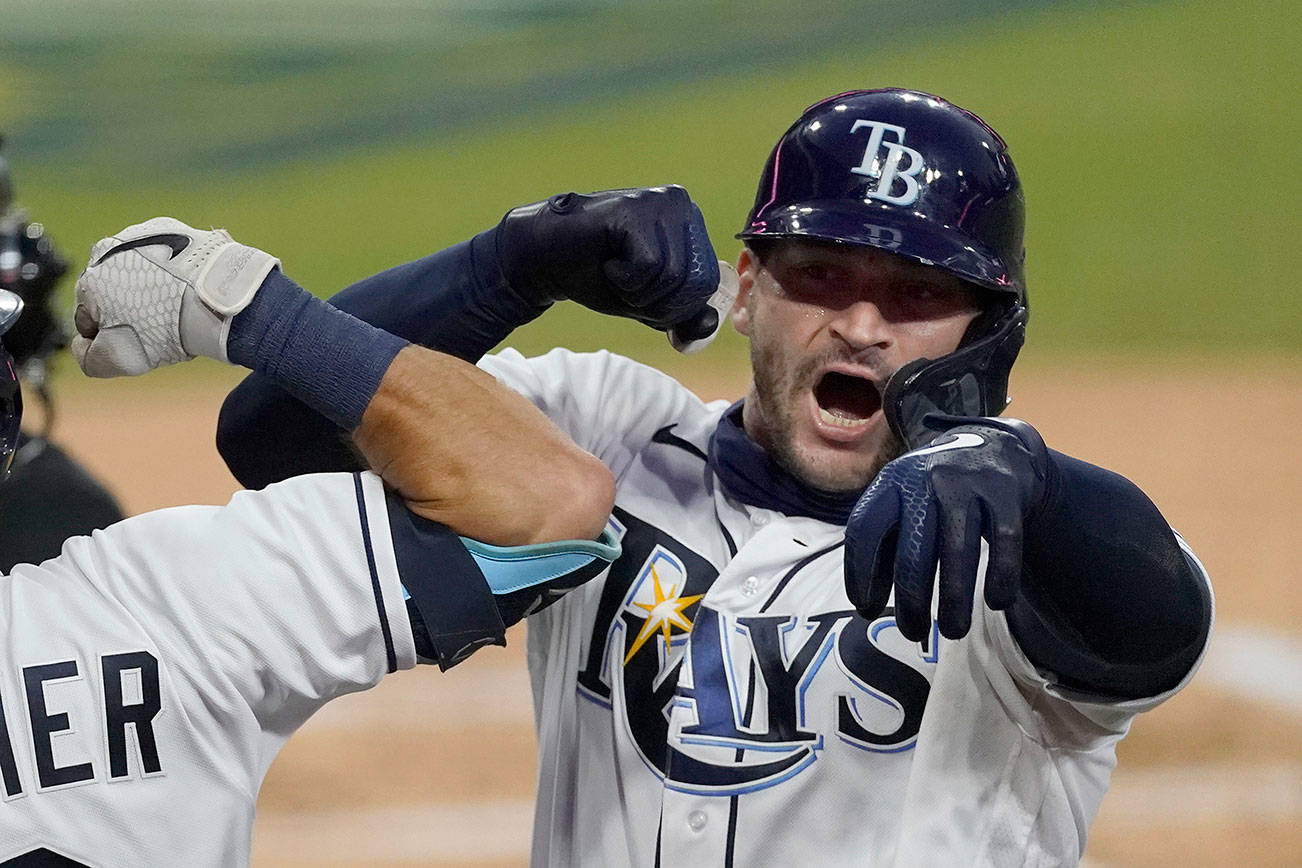 Tampa Bay Rays' Mike Zunino celebrates his solo home run against the Houston Astros during the second inning in Game 7 of a baseball American League Championship Series, Saturday, Oct. 17, 2020, in San Diego. (AP Photo/Ashley Landis)