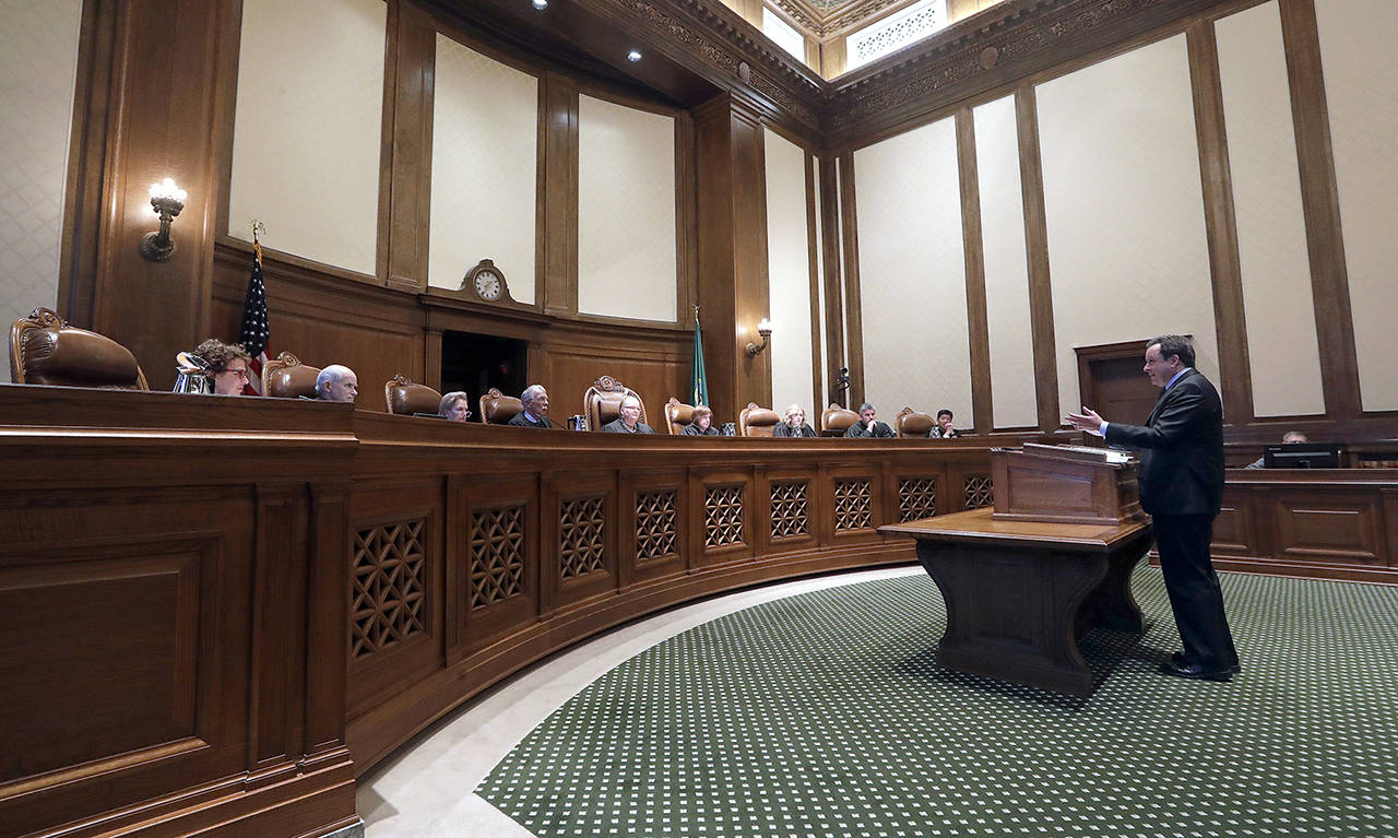 An attorney addresses justices on the Supreme Court of Washington in June 2019 during a case regarding whether state lawmakers are subject to public records law. Since this hearing, two new justices were appointed to vacancies on the court and are being challenged in the November election. (Elaine Thompson / Associated Press file photo)