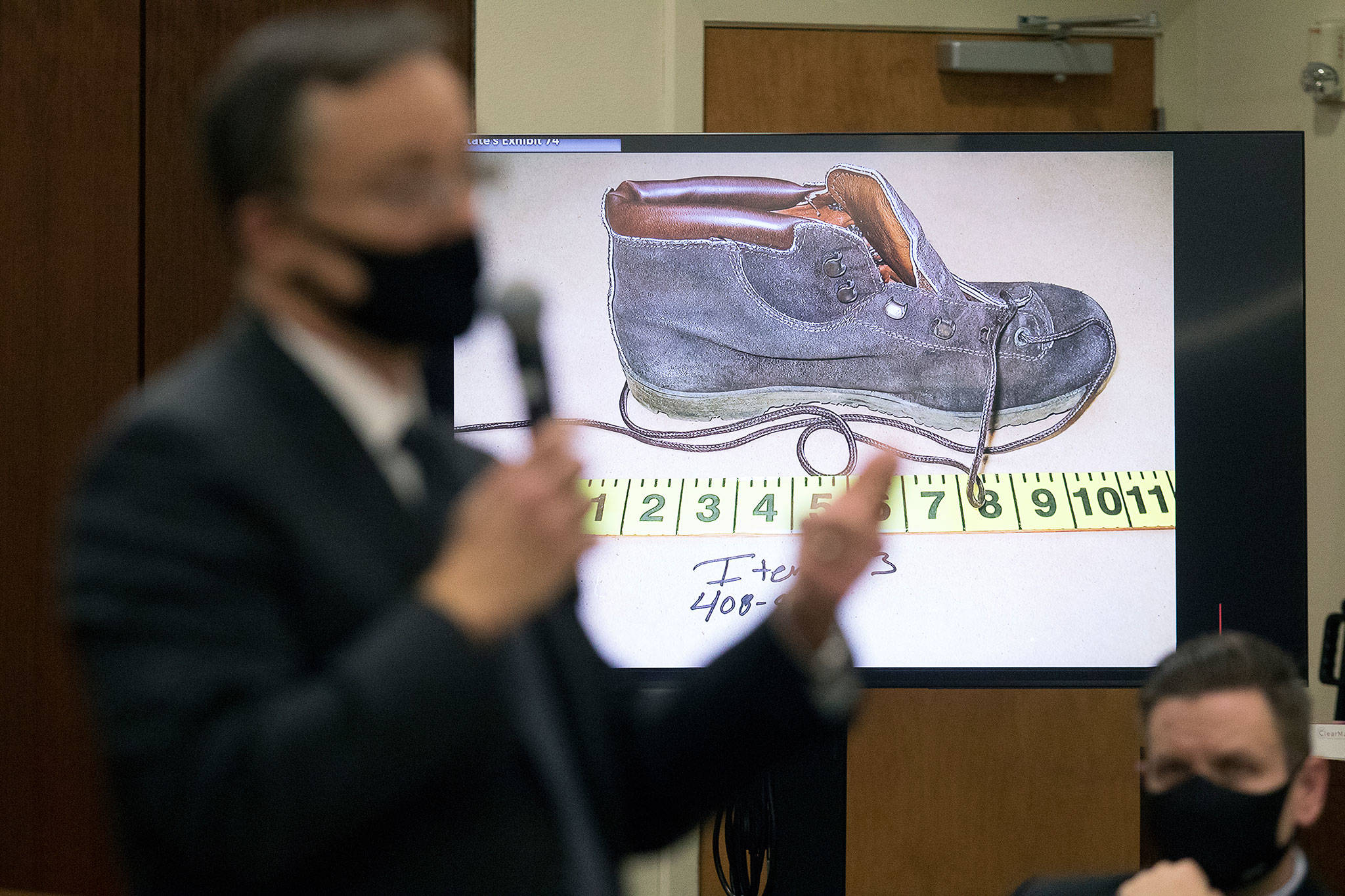 Snohomish County deputy prosecutor Craig Matheson talks about DNA found on a shoe, worn by Jody Loomis, during his opening statement in the murder trial of Terrence Miller at the Snohomish County Courthouse on Monday in Everett. (Andy Bronson / The Herald)