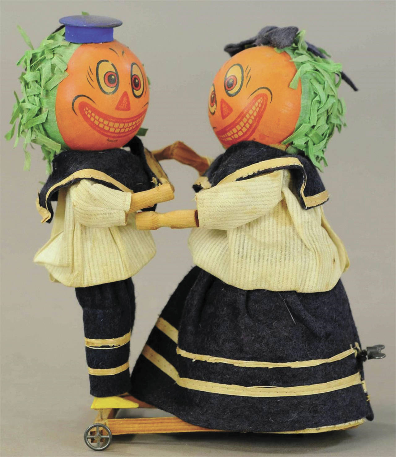 The pumpkin-head dancers are wearing their original blue felt and cotton sailor outfits. They are 8½ inches tall and in excellent working condition, so a collector paid $1,920. (Cowles Syndicate Inc.)