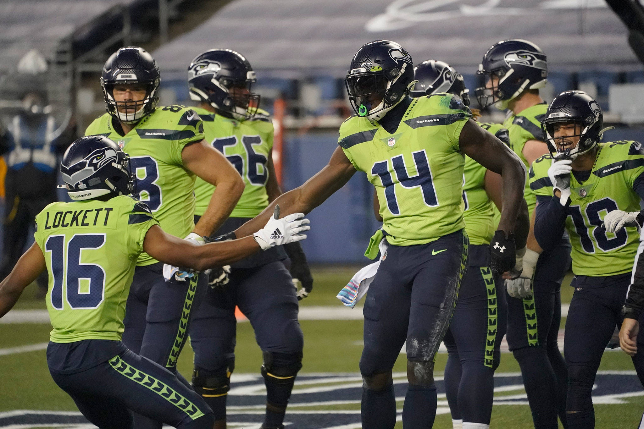The Seahawks' DK Metcalf (14) celebrates his touchdown against the Vikings during the second half of a game Oct. 11, 2020, in Seattle. (AP Photo/Ted S. Warren)