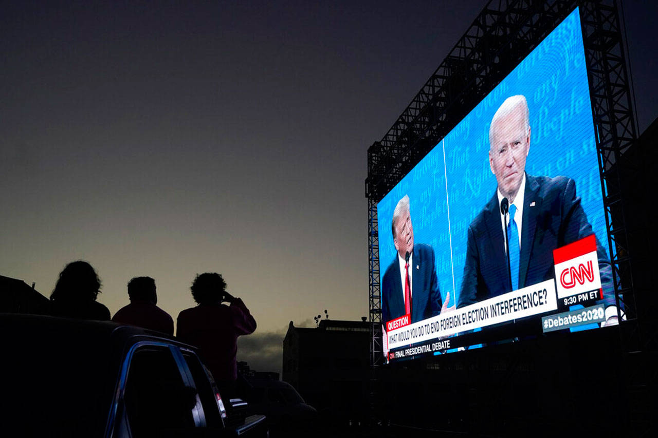 People watch from their vehicle as President Trump and Democratic presidential candidate former Vice President Joe Biden speak during a Presidential Debate Watch Party at Fort Mason Center in San Francisco, Thursday. (Jeff Chiu / Associated Press)