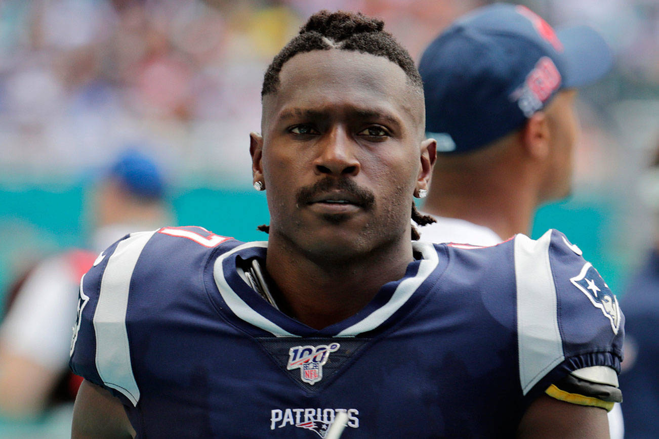 FILE - In this  Sept. 15, 2019, file photo, New England Patriots wide receiver Antonio Brown (17) on the sidelines, during the first half at an NFL football game against the Miami Dolphins in Miami Gardens, Fla. NFL free agent Antonio Brown turned himself in at a Florida jail on Thursday night, Jan, 24, 2020, following accusations that he and his trainer attacked another man. (AP Photo/Lynne Sladky, File)