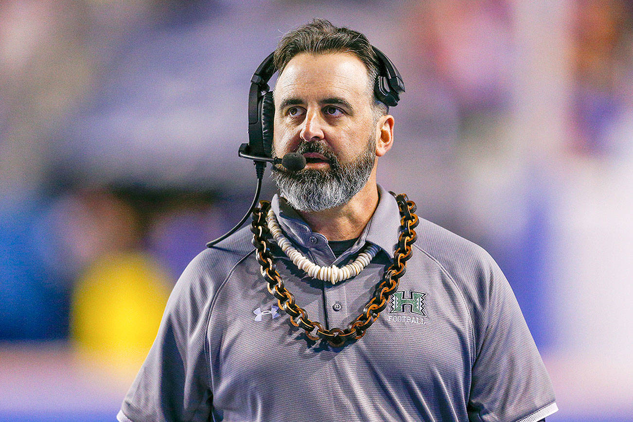 FILE - In this Saturday, Oct. 12, 2019, file photo, then-Hawaii head coach Nick Rolovich walks the sideline during the second half of an NCAA college football game against Boise State, in Boise, Idaho. It took nine months for Rolovich, the new Washington State football coach, to conduct his first practice with the Cougars after the coronavirus led to the cancellation of spring practice and delays in the start of the 2020 season. Rolovich was hired from Hawaii in January after Mike Leach left for Mississippi State. (AP Photo/Steve Conner, File)