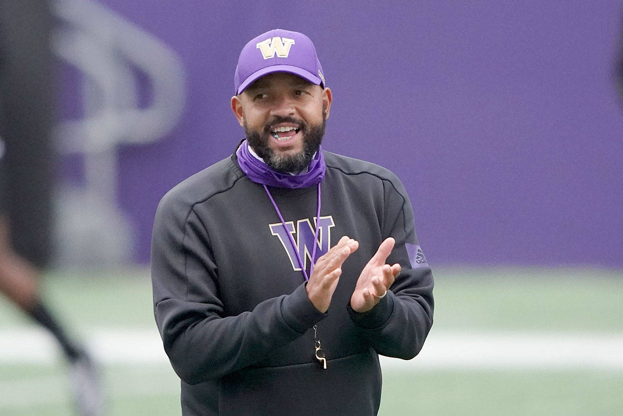 First-year Washington head coach Jimmy Lake calls to his team during practice Oct. 16. (Ted S. Warren / Associated Press)