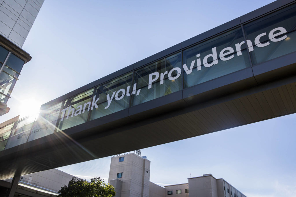 "A ""thank you"" to health care workers on the skybridge at Providence Regional Medical Center Everett. (Olivia Vanni / The Herald)"
