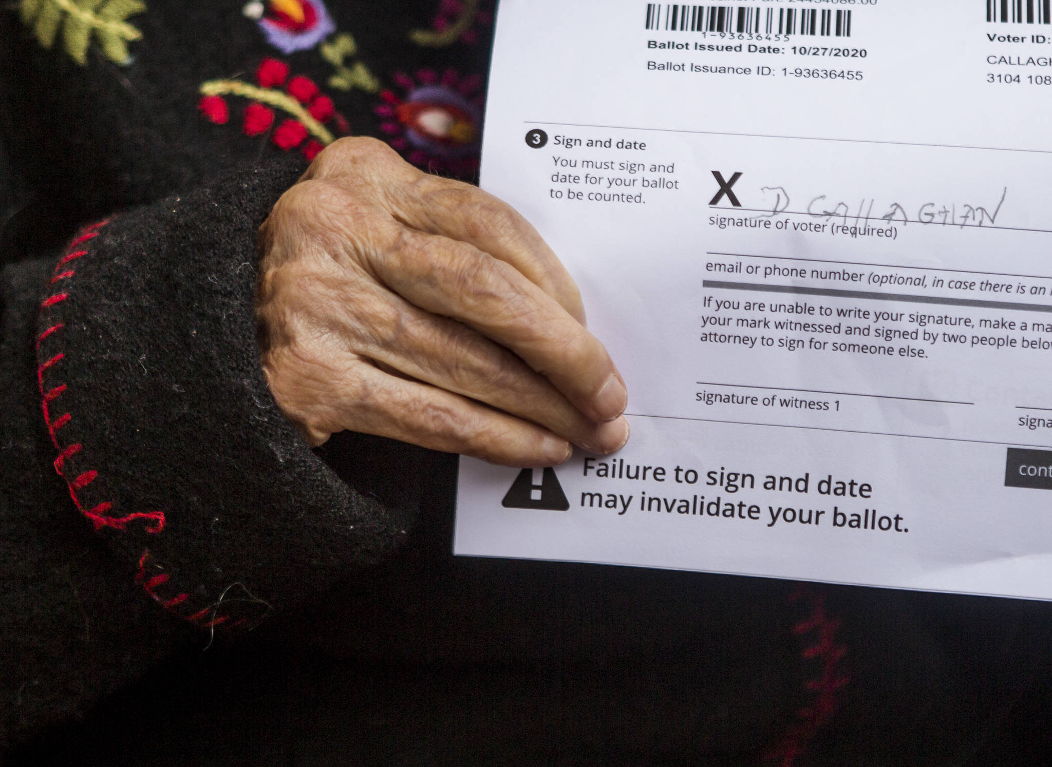 Doris Callaghan holds her signed ballot on Friday in Mukilteo. (Olivia Vanni / The Herald)