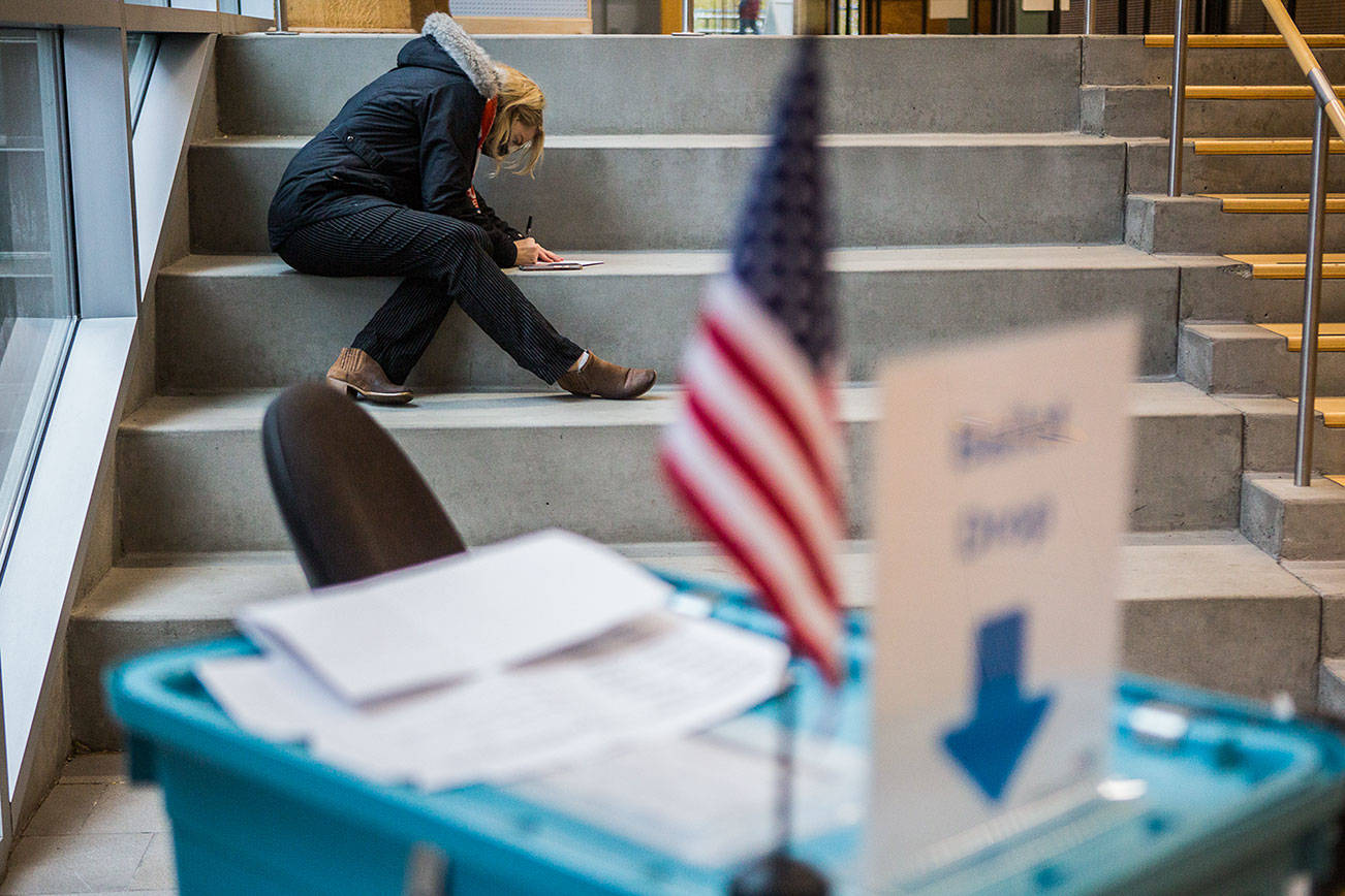 A voter fills out a ballot outside of the County Public Meeting Room on Tuesday, Nov. 3, 2020 in Everett, Wa. (Olivia Vanni / The Herald)