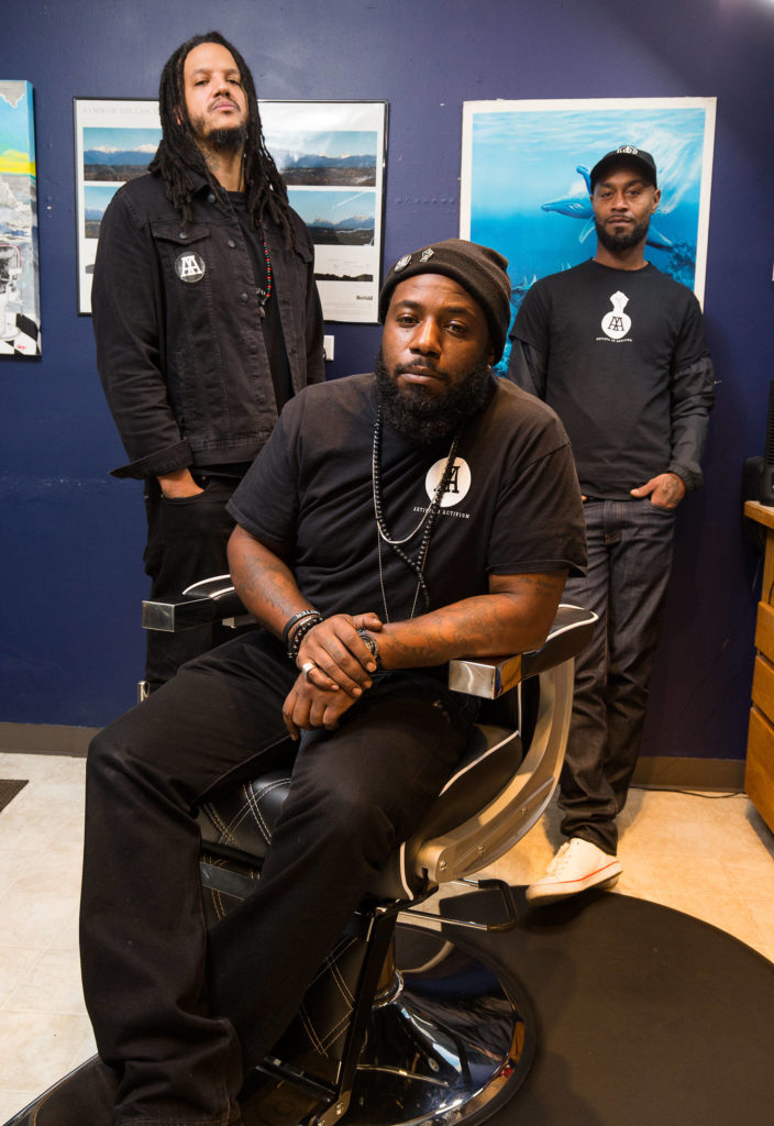"""Elton Davis Sr., Jordan Jeffries and Chris Anderson have started an initiative, coined """"Cops and Barbers,"""" is meant to foster honest conversations about race and policing between Black residents and Snohomish County sheriff's deputies. (Andy Bronson / The Herald)"""