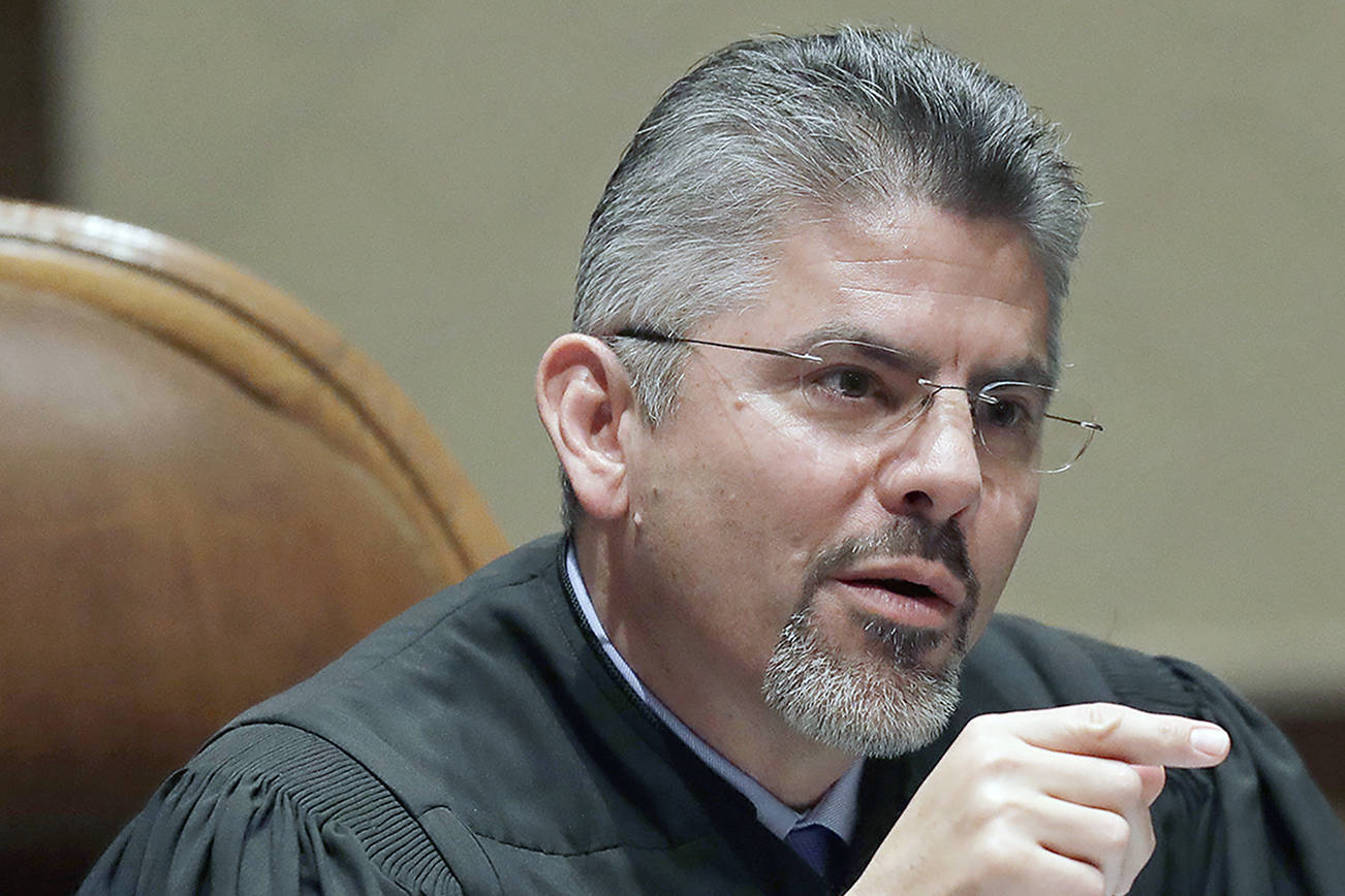 FILE - In this Jan. 22, 2019, file photo, Washington Supreme Court Justice Steven González listens to testimony during a hearing in Olympia, Wash. González has been elected as the next chief justice of the Washington state Supreme Court. He was elected by his colleagues on Thursday, Nov. 5, 2020, according to a news release sent by the court. (AP Photo/Ted S. Warren, File)