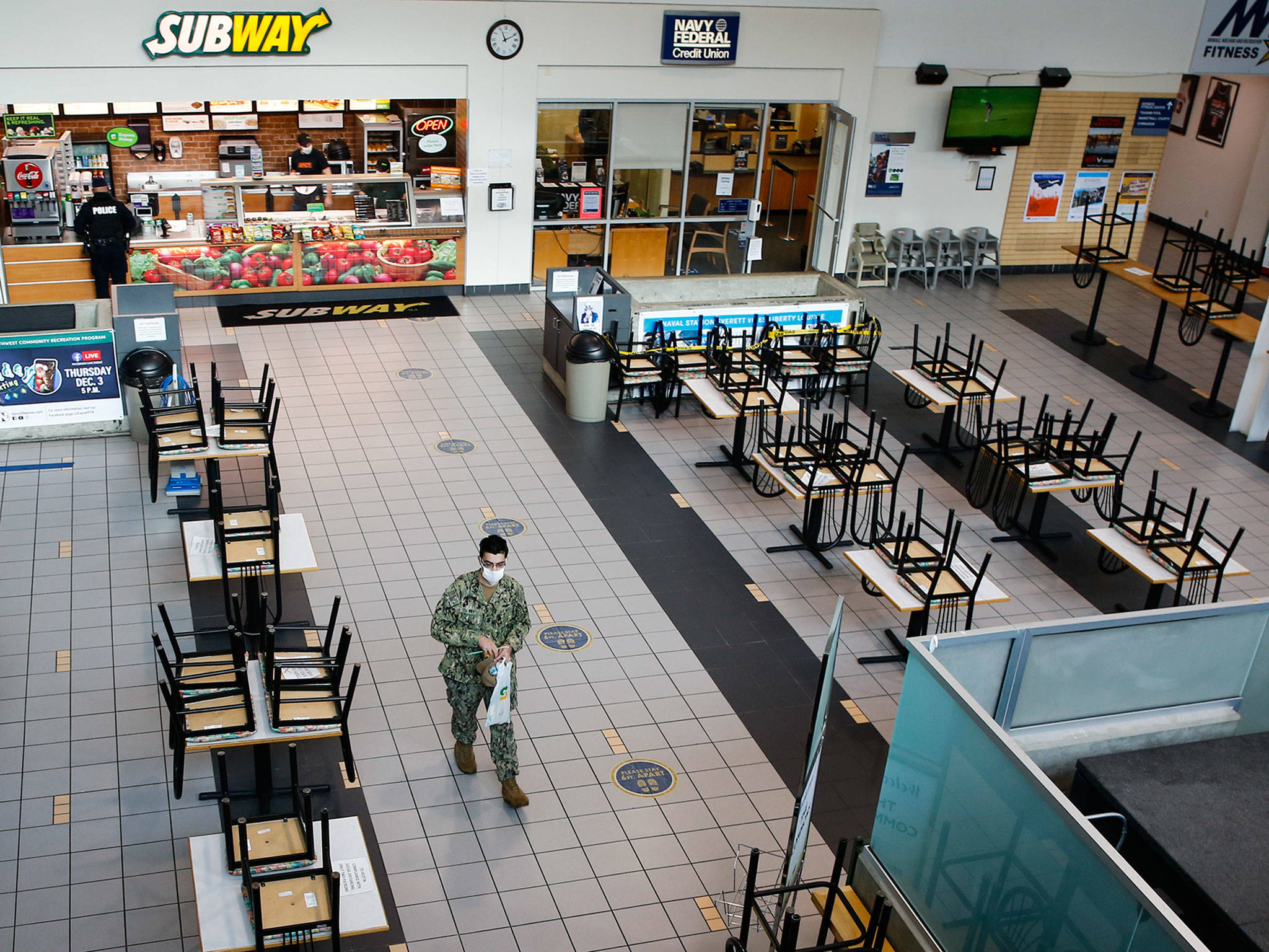 Tables and chairs are unavailable at The Commons at Naval Station Everett due to coronavirus restrictions. (Kevin Clark / The Herald)
