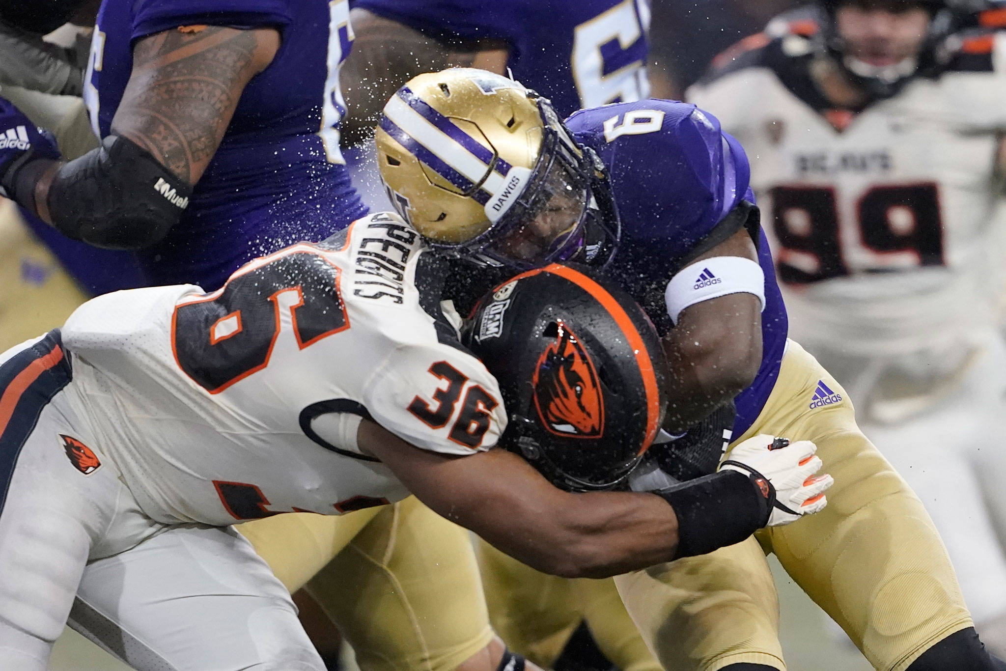 Washington running back Richard Newton collides with Oregon State linebacker Omar Speights during the first half of a game Nov. 14, 2020, in Seattle. (AP Photo/Ted S. Warren)