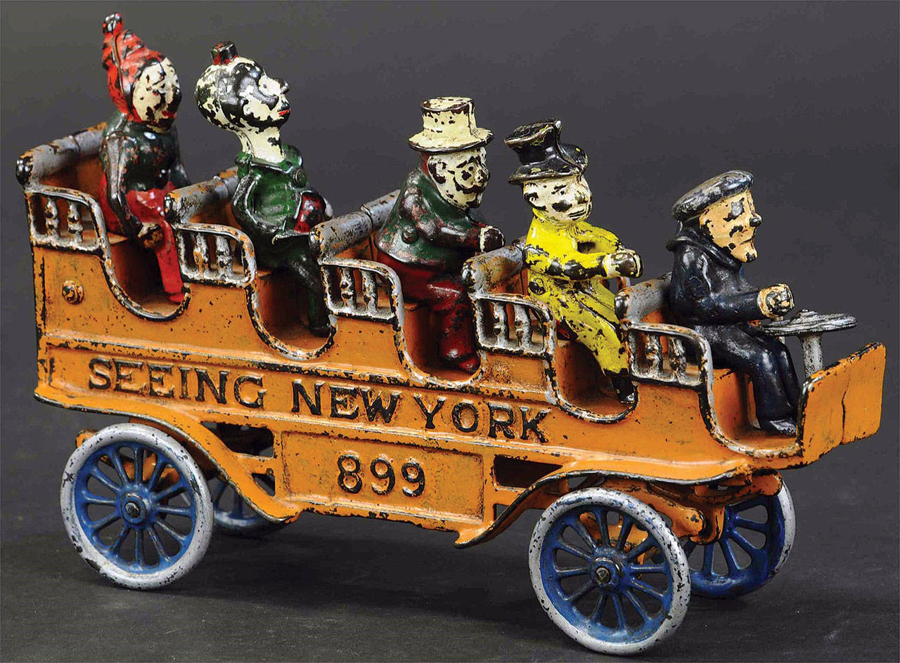 This toy tourist bus was made about 1910 by the Kenton Hardware Co. in Ohio. Not all of the passengers were part of the original toy, but suitable replacements had been found. It is a rare toy — so rare it auctioned for a little over $1,000. (Cowles Syndicate Inc.)