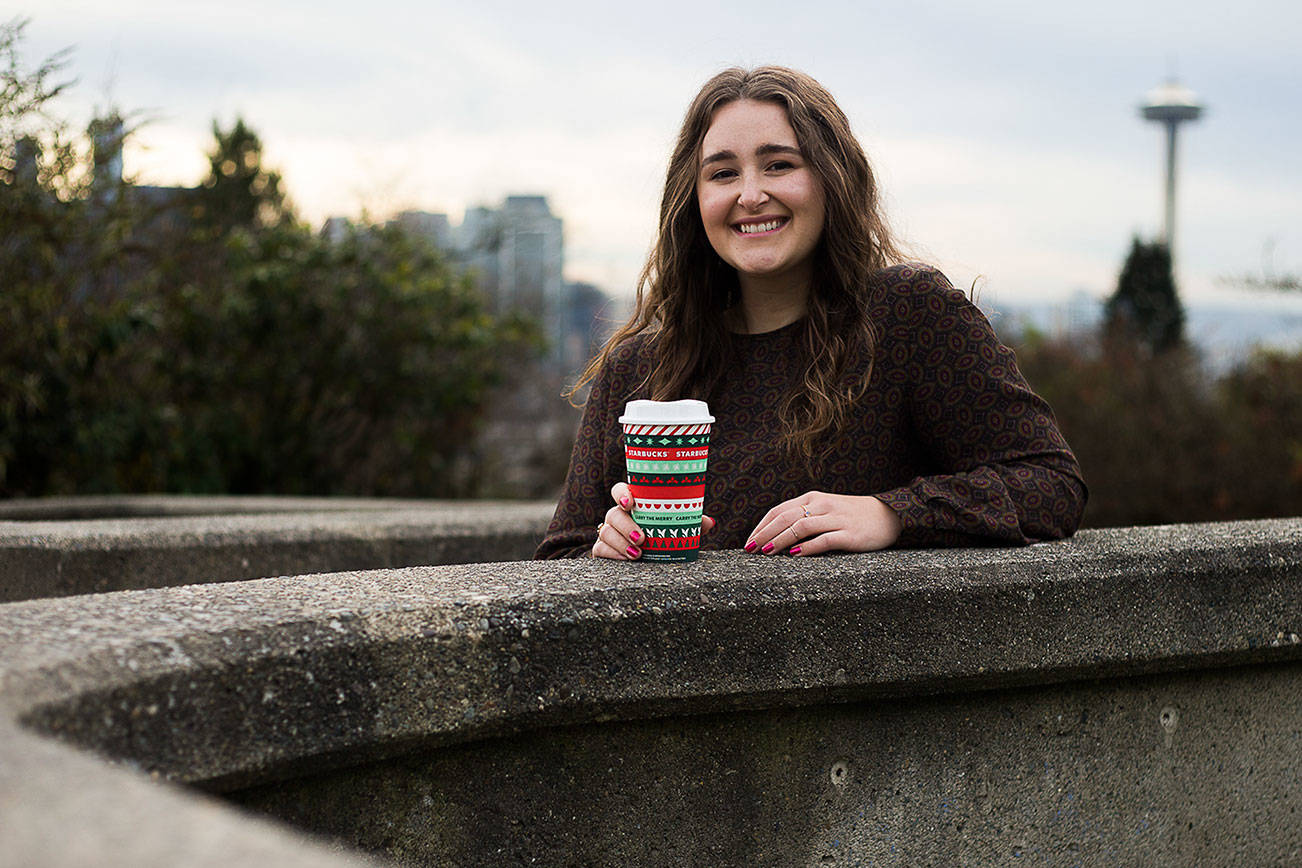 Taylor Mattson, 27, an Everett High School graduate, designed two of Starbucks holiday cups for this year. (Olivia Vanni / The Herald)