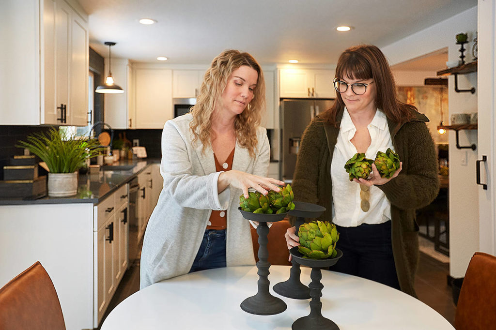 "Twins Leslie Davis, left, and Lyndsay Lamb stage a house in Everett as seen on ""Unsellable Houses"" on HGTV. (HGTV photo)"
