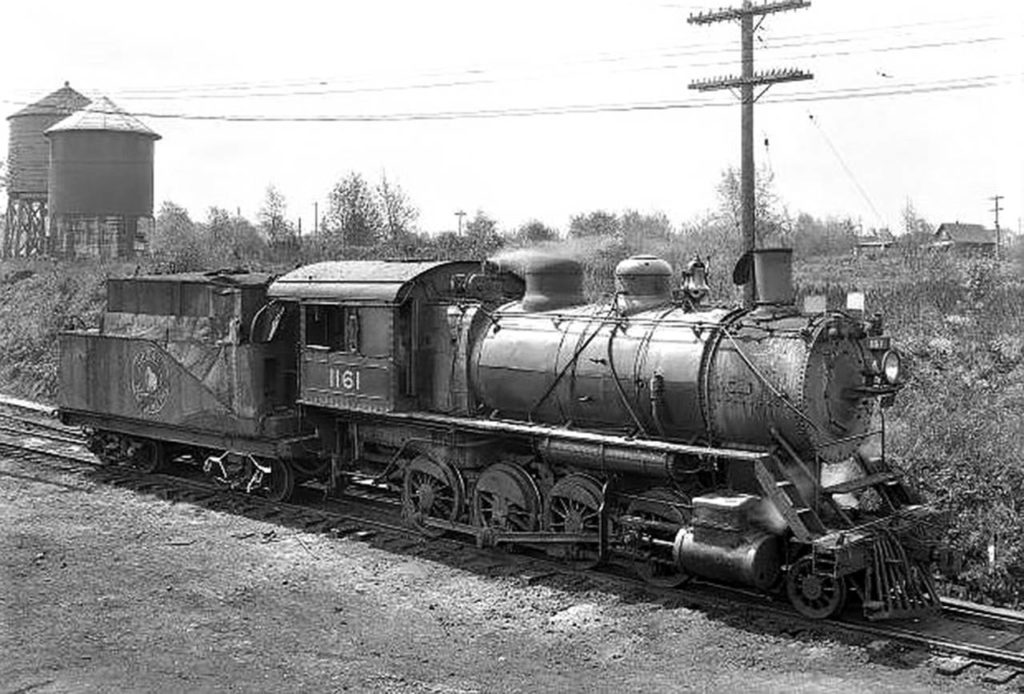 Great Northern locomotive No. 1161, shown in this J.A. Juleen photo taken in 1933 at the Delta Yards in Everett, was built between 1901 and 1907. These F-8 class 2-8-0 locomotives, built to haul freight trains, were originally coal-powered steam engines. By the time this photo was taken, it likely ran on oil. (Everett Public Library, J.A. Juleen)