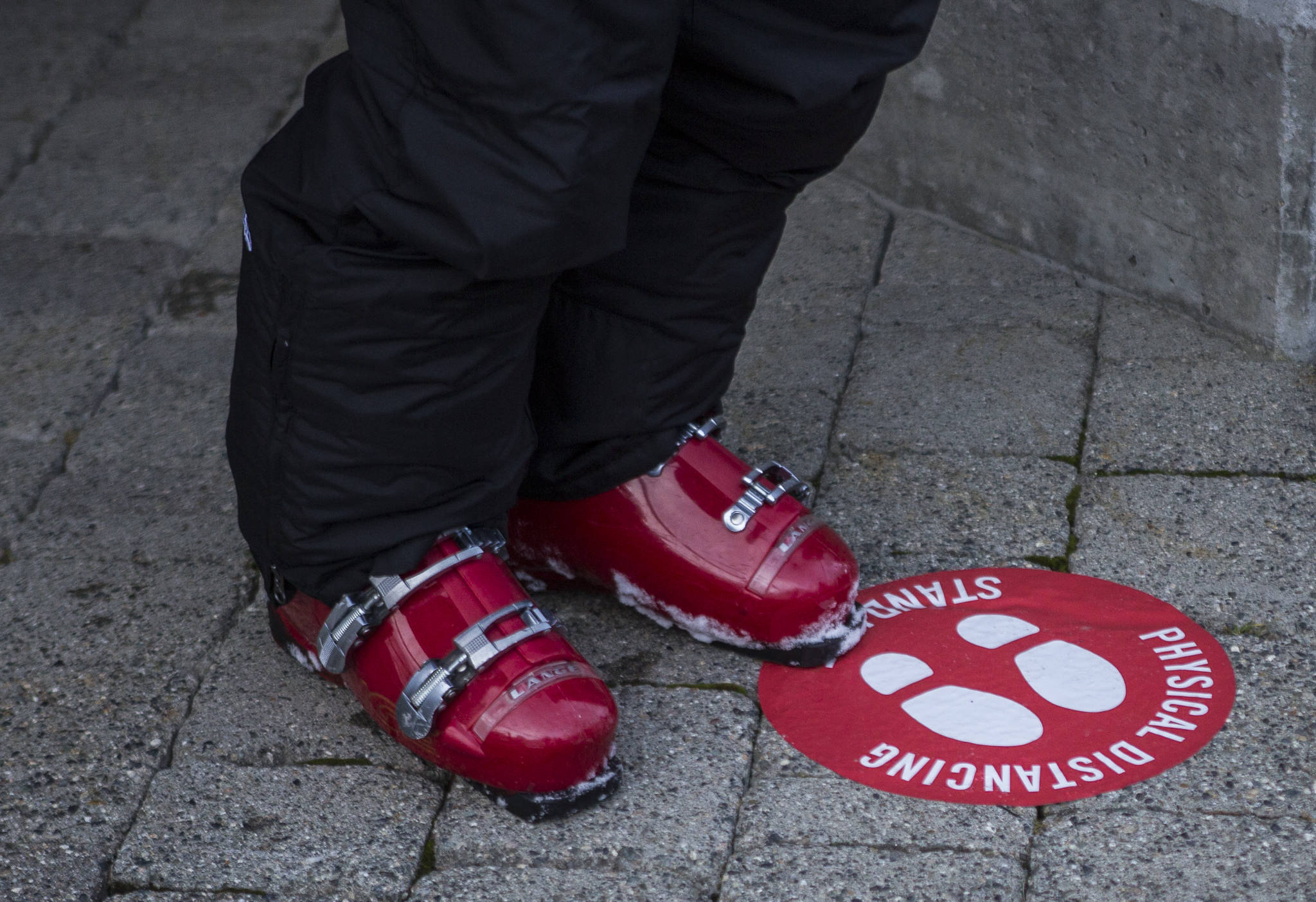 Floor stickers encourage social distancing at Stevens Pass. (Olivia Vanni / The Herald)