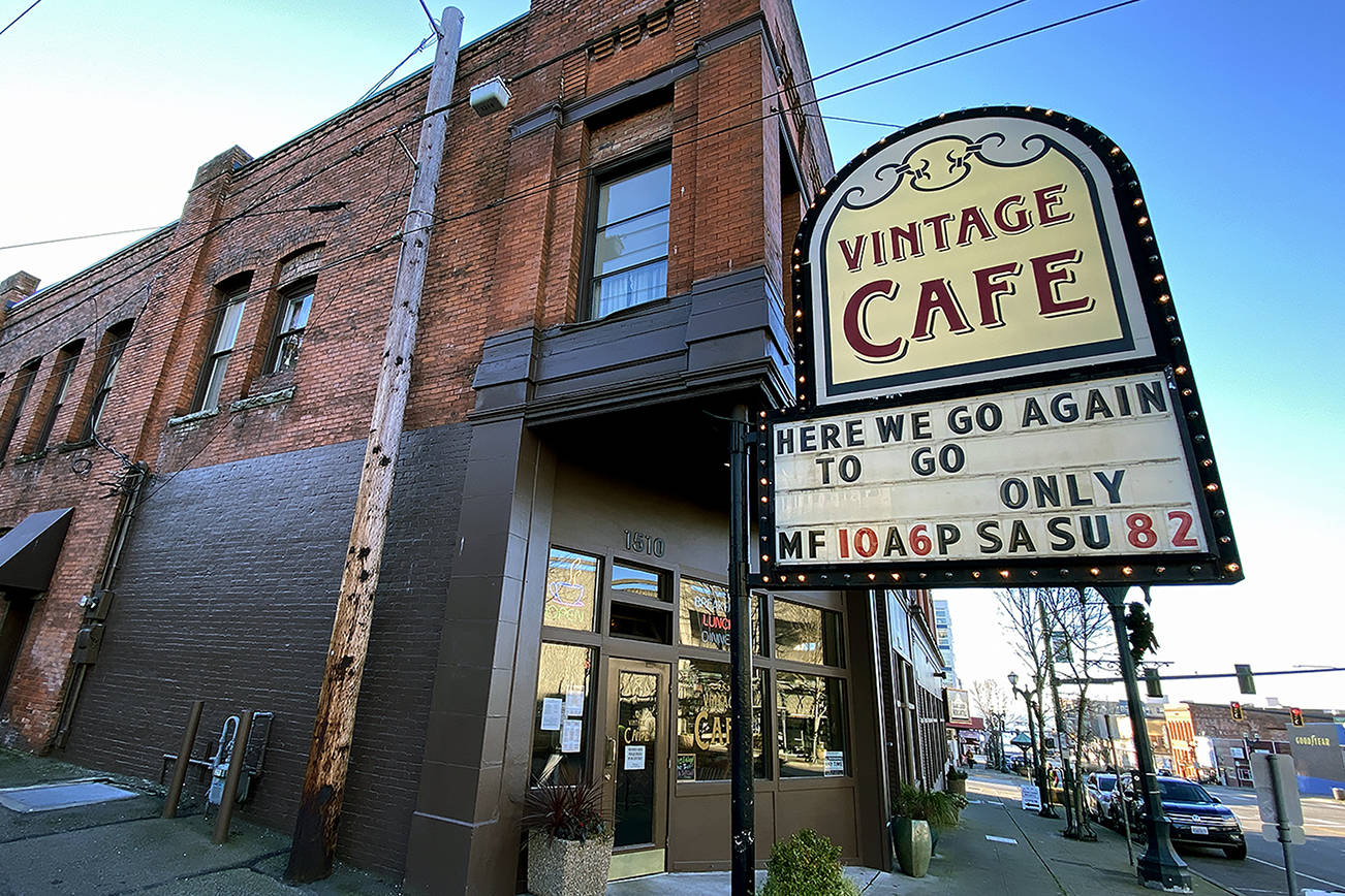 """A """"Here we go again"""" sign is seen at the Vintage Cafe in Everett on Dec. 4. (Sue Misao / The Herald)"""