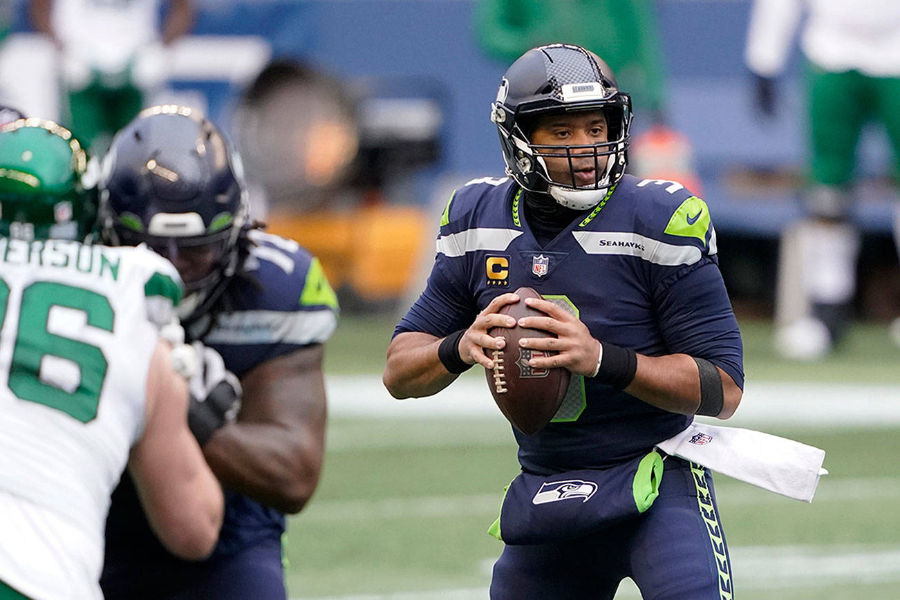 Seattle Seahawks quarterback Russell Wilson looks downfield against the New York Jets during the first half of an NFL football game, Sunday, Dec. 13, 2020, in Seattle. (AP Photo/Ted S. Warren)