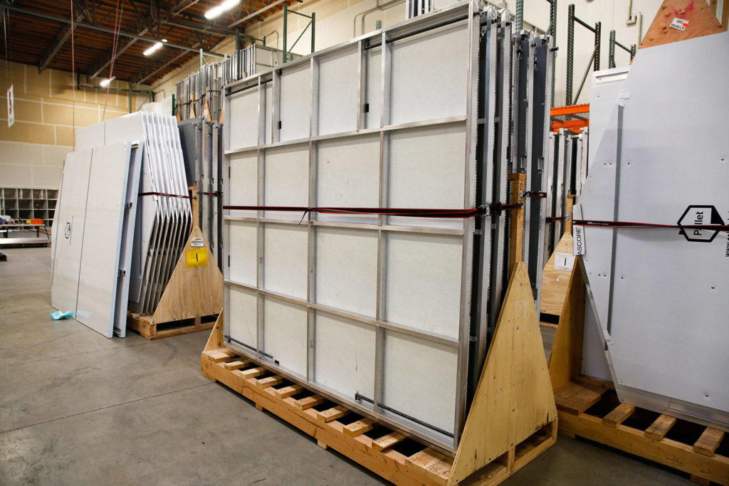 Shelters await shipping and assembly at Pallet in Everett. (Kevin Clark / The Herald)
