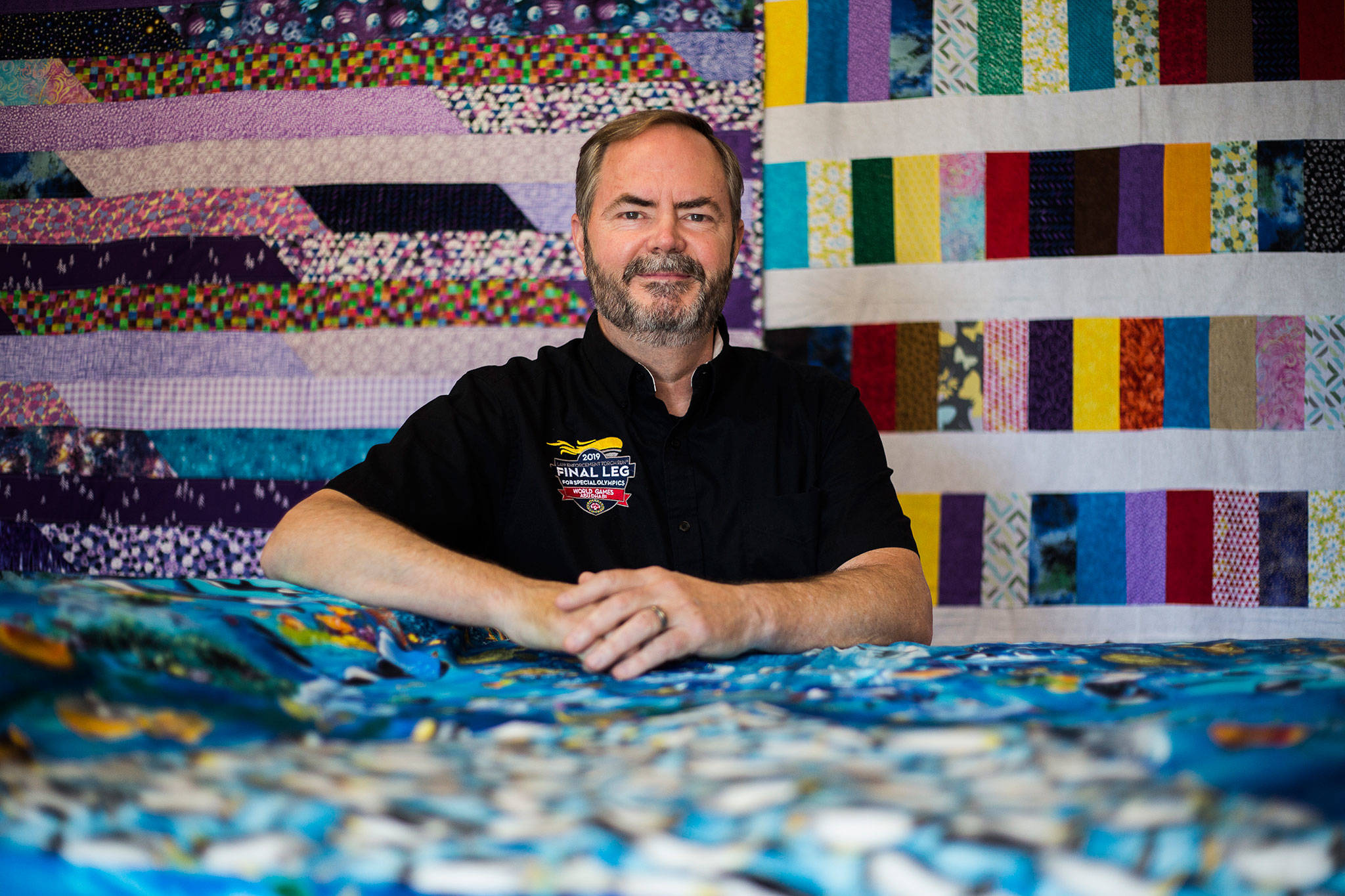 Red Caldwell in his home workshop in Brier, where he makes quilts for donation to charity. (Olivia Vanni / The Herald)