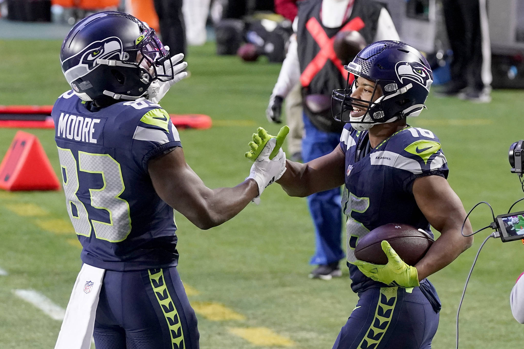 Seattle Seahawks wide receiver Tyler Lockett (16) celebrates with David Moore (83) following Lockett's fourth-quarter touchdown against the San Francisco 49ers Sunday in Glendale, Ariz. (AP Photo/Ross D. Franklin)