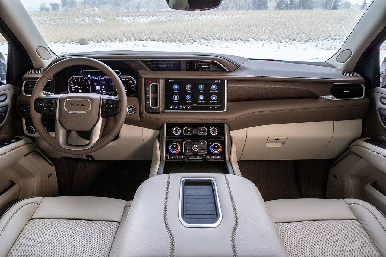 The 2021 GMC Yukon Denali's exclusive interior includes authentic wood trim and hand stitched seats. (Manufacturer photo)