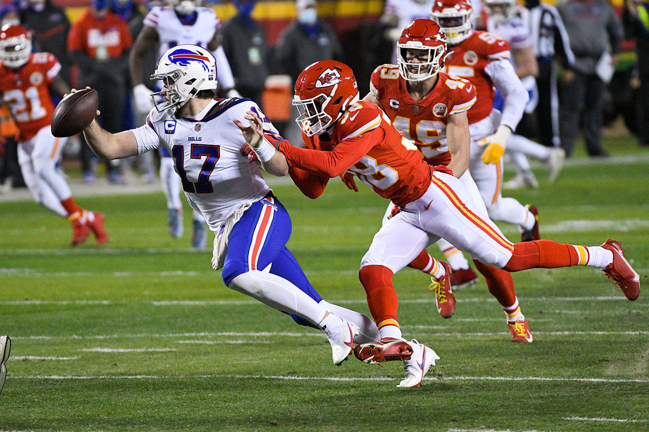 Buffalo Bills quarterback Josh Allen is sacked by Kansas City Chiefs safety L'Jarius Sneed (38) during the first half of the NFL AFC championship football game Sunday in Kansas City, Missouri. (AP Photo/Reed Hoffmann)