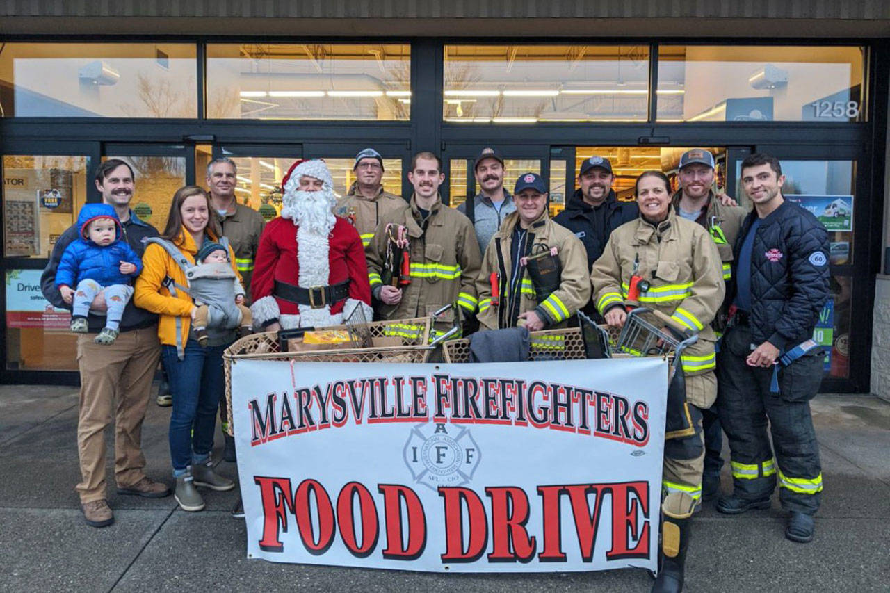 Marysville Professional Firefighters, IAFF Local 3219, recently donated $5,000 to the Marysville Community Food Bank. (Contributed photo)