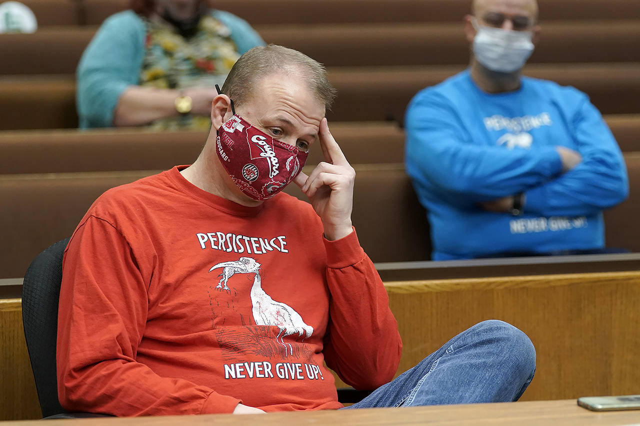 Initiative promoter Tim Eyman listens during a session of Thurston County Superior Court on Wednesday in Olympia. (AP Photo/Ted S. Warren)
