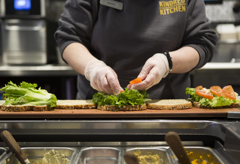 Sandwiches are prepped for delivery at the Kindred Kitchen on Friday in Everett. (Olivia Vanni / The Herald)