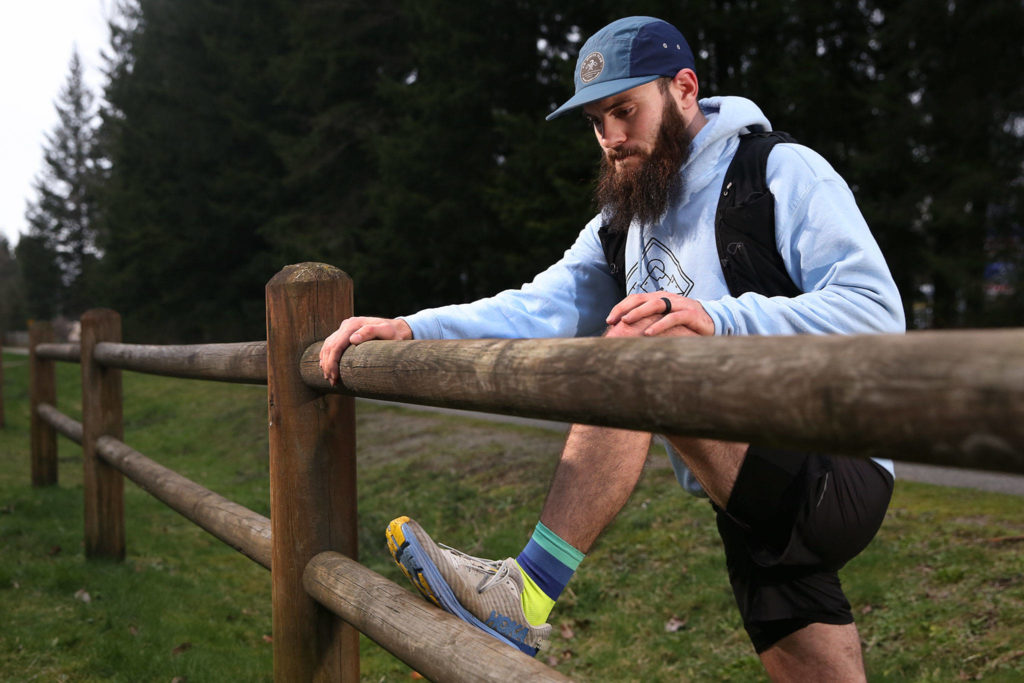 Austin Johnson, 26, trains on the Centennial Trail in Lake Stevens and is planning to do a 24-hour run to raise money for the American Foundation for Suicide Prevention. (Kevin Clark / The Herald)