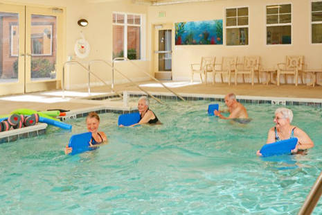 Quail Park of Lynwood residents enjoy a swimming pool, gym outfitted with senior-oriented HUR equipment, a full-time professional instructor and more to support heart-heathly active living.
