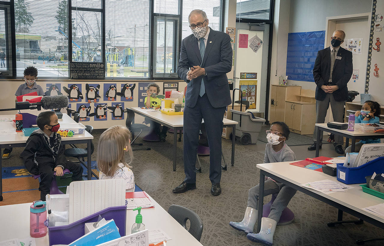 Ellen M. Banner / Associated Press Washington Gov. Jay Inslee speaks with kindergartners in Chelsea Singh's class during a visit to Firgrove Elementary School in Puyallup on Thursday.