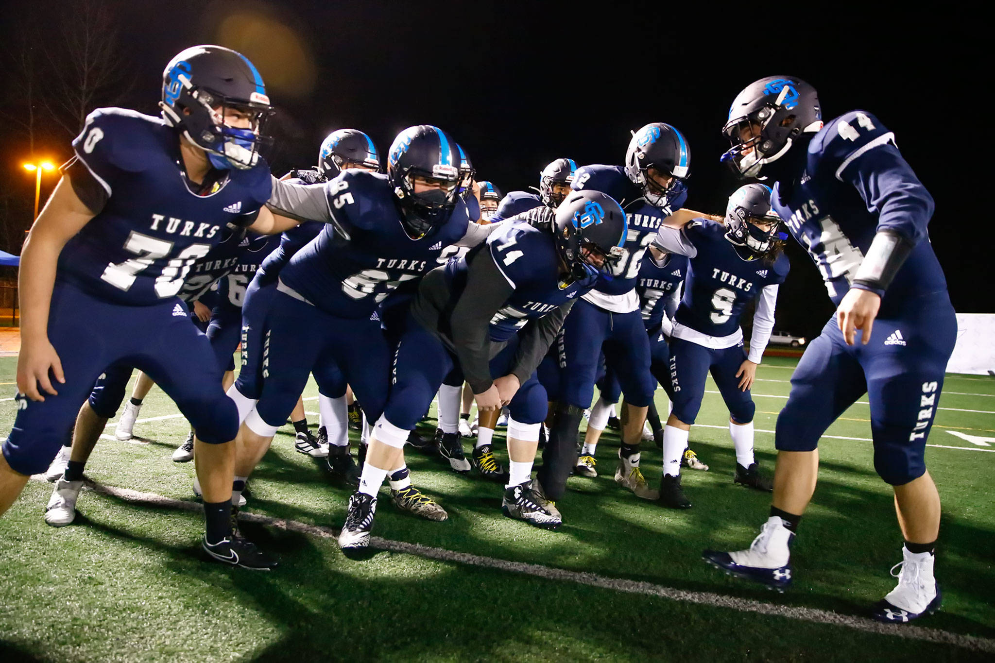 The Sultan High School football team gets fired up before its annual Black and Blue Bowl rivalry game against Granite Falls on Friday night. It marked the first Snohomish County prep football game in more than 15 months. (Kevin Clark / The Herald)