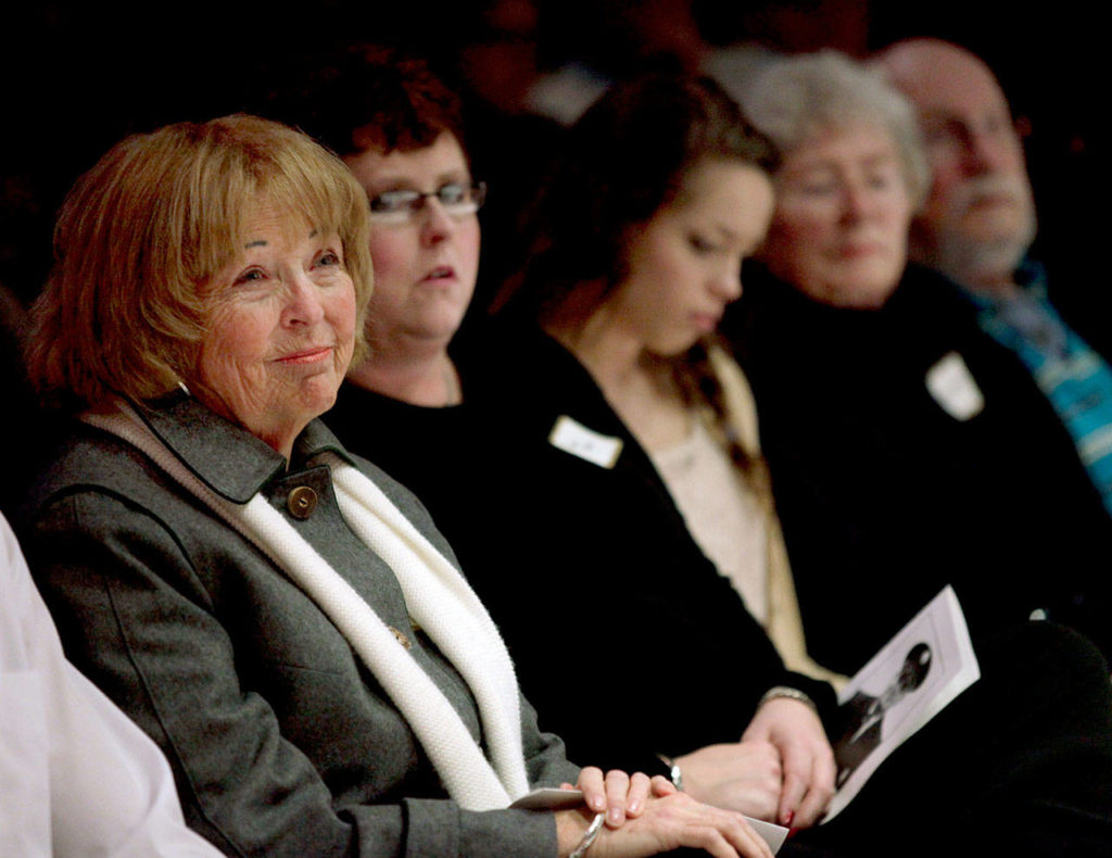 Kathy Parks and family members listen to speakers during the Gary Parks Remembrance ceremony at Everett Community College in 2012. From left: Kathy Parks, daughter Jennifer Parks, granddaughter Marissa Van Ry, Carol and bother John Parks. (Michael O'Leary / Herald file)