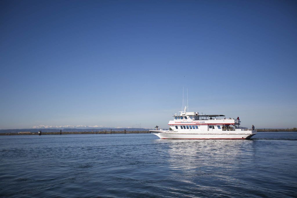 The Island Explorer 4 pulls outs of the Port of Everett Marina. Island Adventures Whale Watching is back in operation after closing for several months last year due to the coronavirus pandemic. (Olivia Vanni / The Herald)