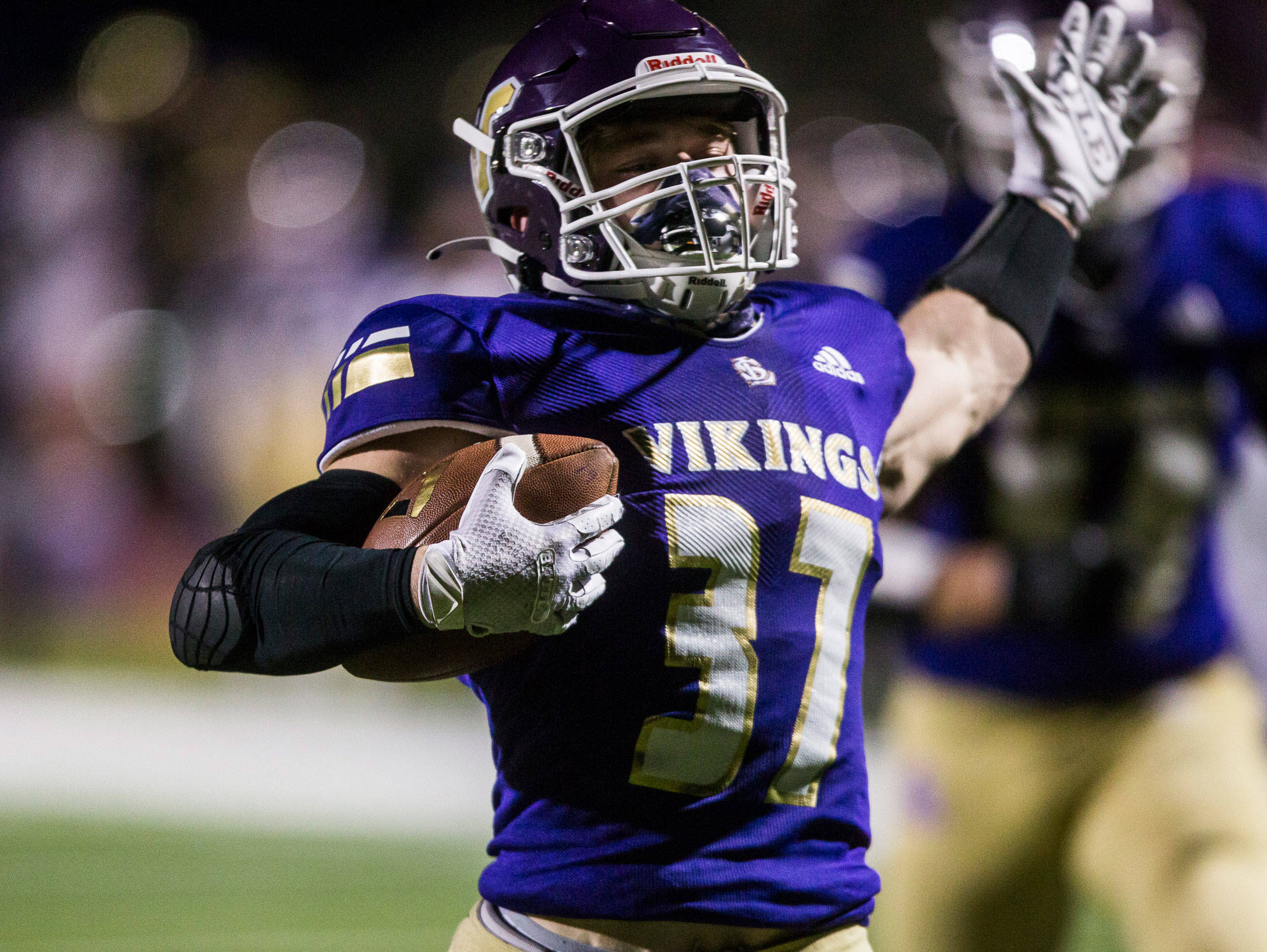 Lake Stevens running back Jay Roughton runs in for a touchdown during a game against Archbishop Murphy on March 6 in Lake Stevens. (Olivia Vanni / The Herald)