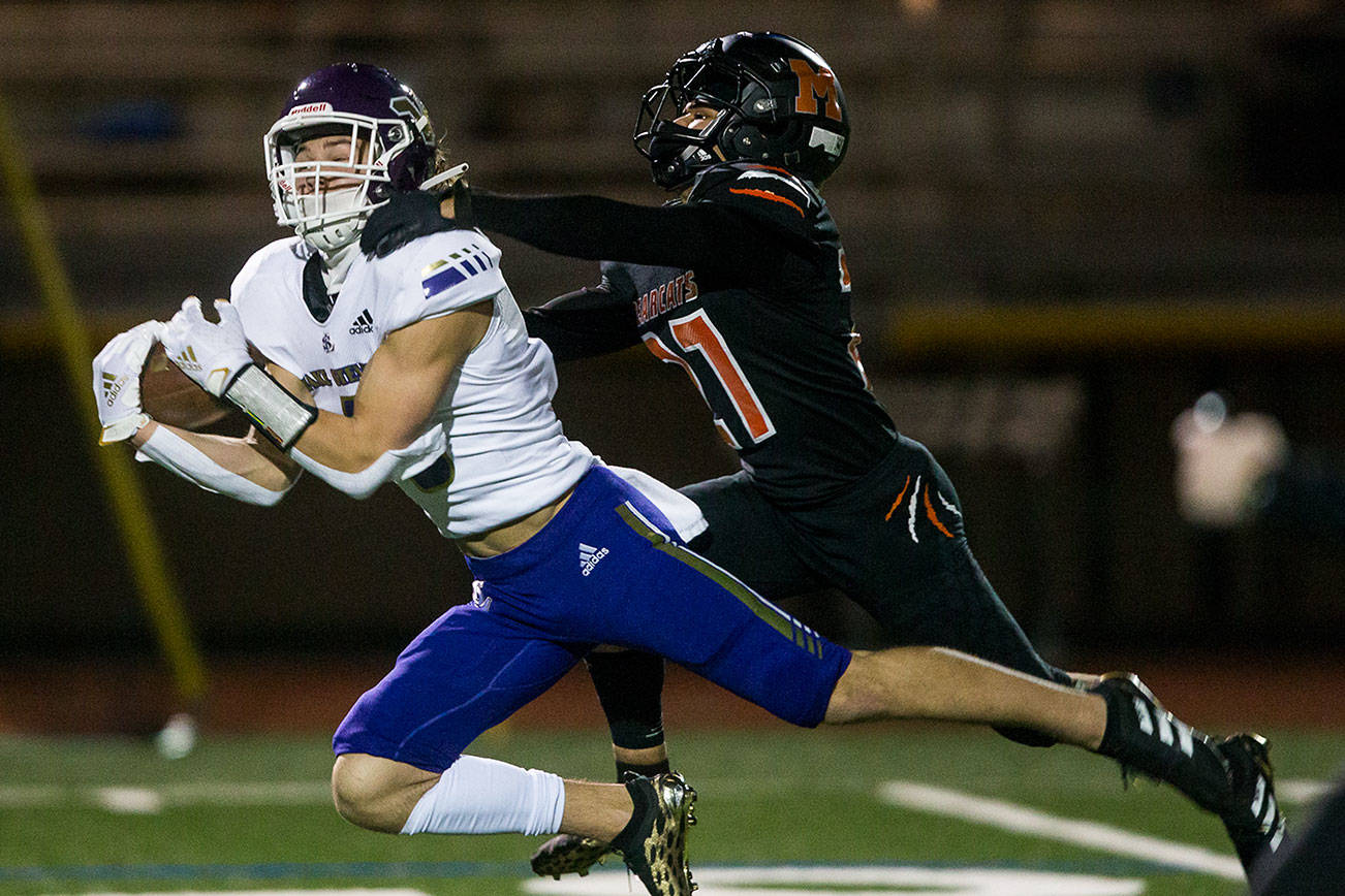 Lake Stevens' Drew Carter makes a catch past Monroe's Trey Lane during the game on Friday, March 12, 2021 in Monroe, Wa. (Olivia Vanni / The Herald)