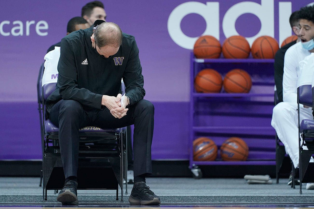 Washington head coach Mike Hopkins sits on the bench before an NCAA college basketball game against Southern California, Thursday, Feb. 11, 2021, in Seattle. (AP Photo/Ted S. Warren)