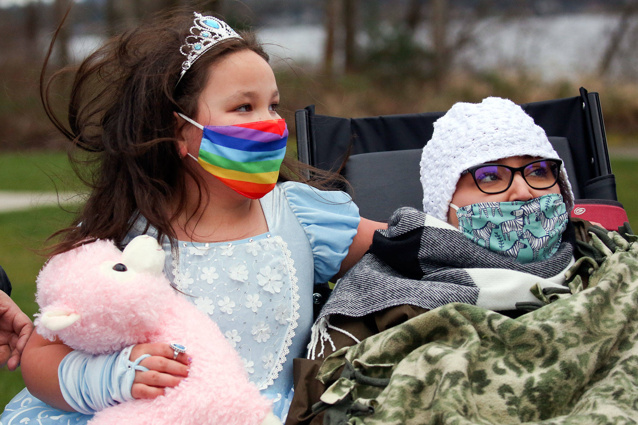 Madelynne Erickson (left) with her mother Bethany Erickson during a fundraiser at Lundeen Park in Lake Stevens on March 6. (Kevin Clark / The Herald)