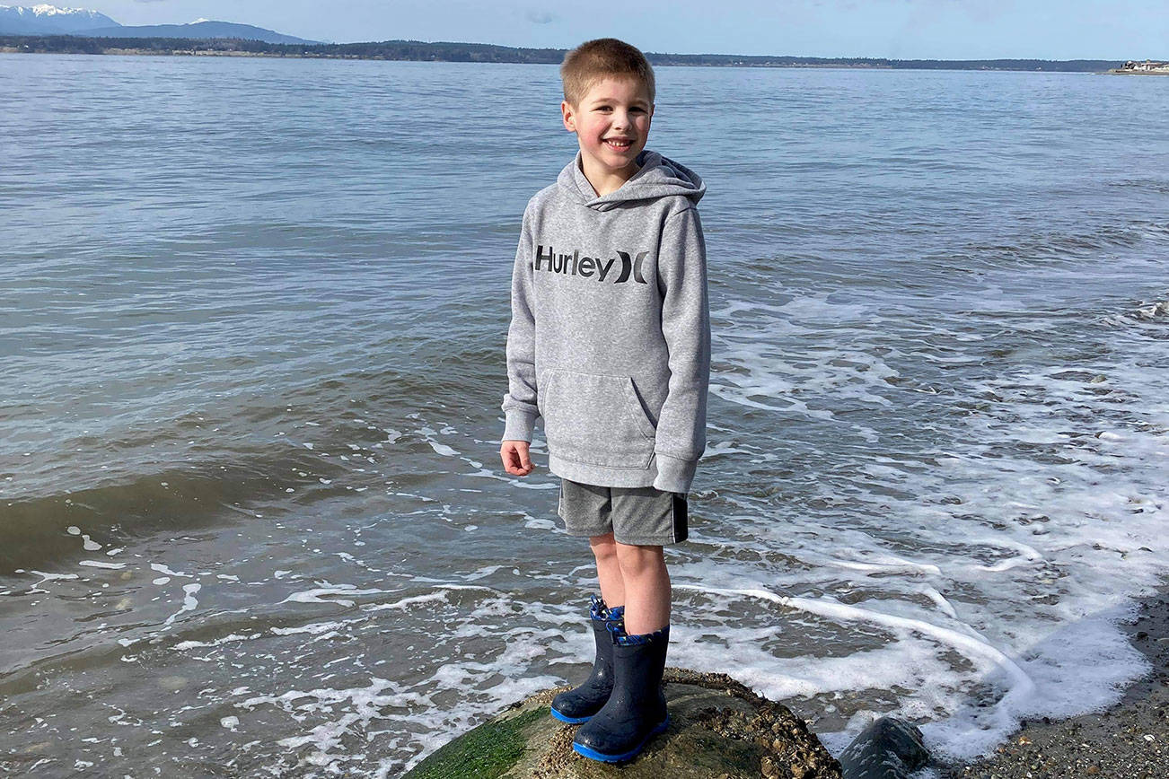 Blake Lewis, 7, at Bush Point where he threw a message in a bottle out to sea. Ruth Smethers later picked it up in Port Townsend. Photo provided by Jessie Lewis