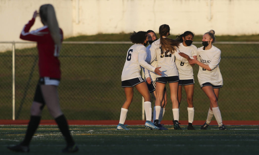 Glacier Peak celebrates a goal by Abi Vargheseas during a girls soccer match against Snohomish at Veterans Memorial Stadium on Monday in Snohomish. (Andy Bronson / The Herald)