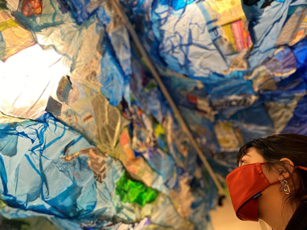 """Amber Vincini looks up at """"The Wave"""" installation by Maria Phillips."""