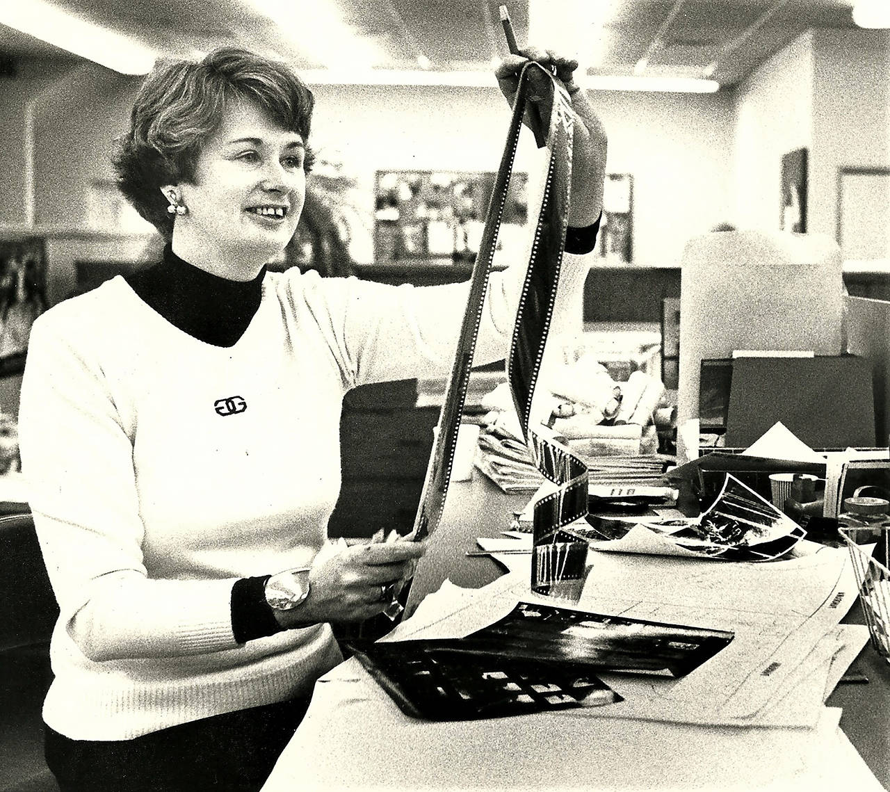 Jeanne Metzger, who retired from the Herald in 1990, works with film as editor of the newspaper's Panorama magazine. Metzger died Wednesday at age 89. (Herald archives)