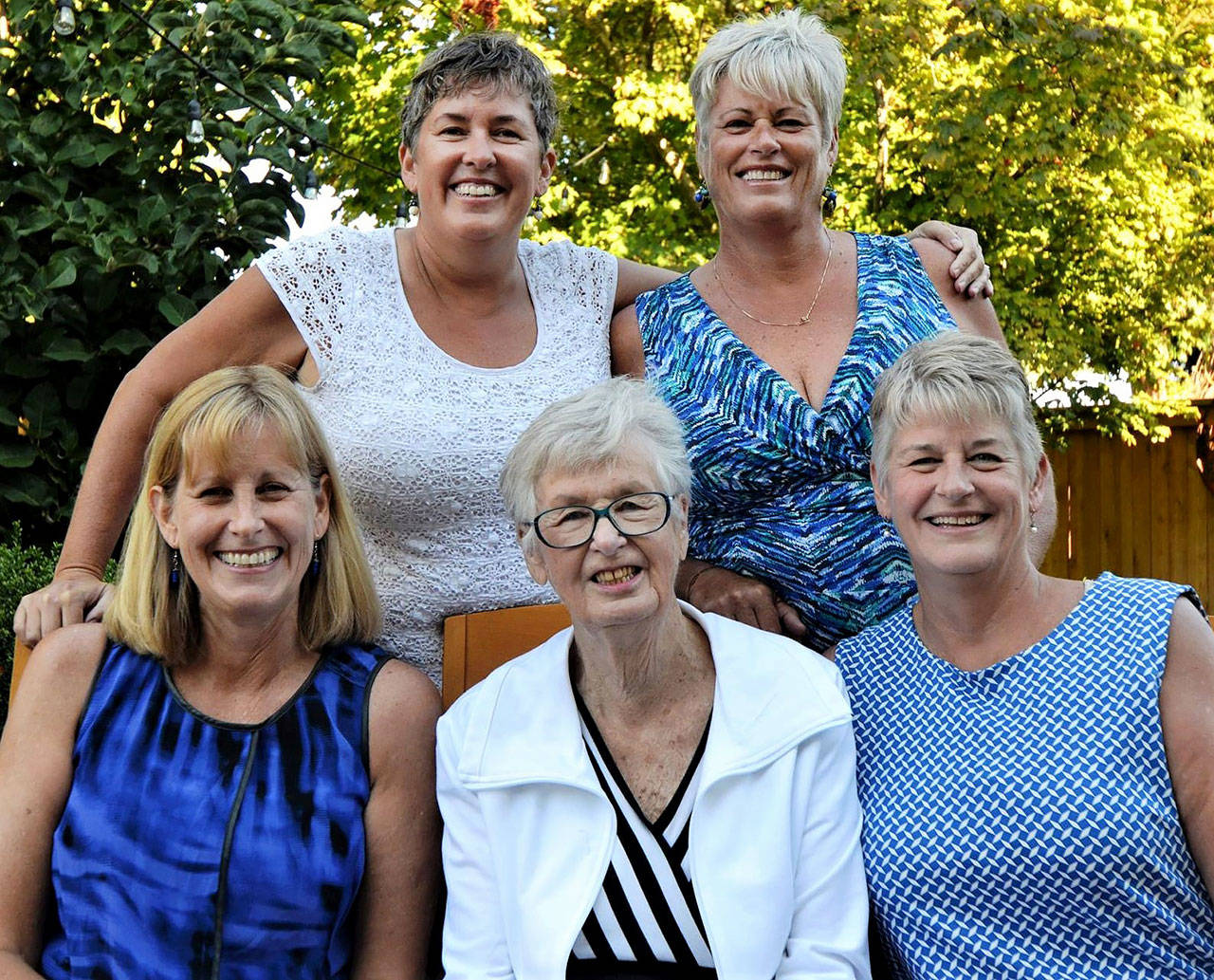 Jeanne Metzger (center, bottom row) on her 85th birthday with daughters Maddy Metzger-Utt (top left), Jo Metzger-Levin (top right), Meg Metzger (bottom left) and Jan Brossman (bottom right). A longtime Herald editor, Jeanne Metzger died Wednesday at age 89. (Contributed photo)