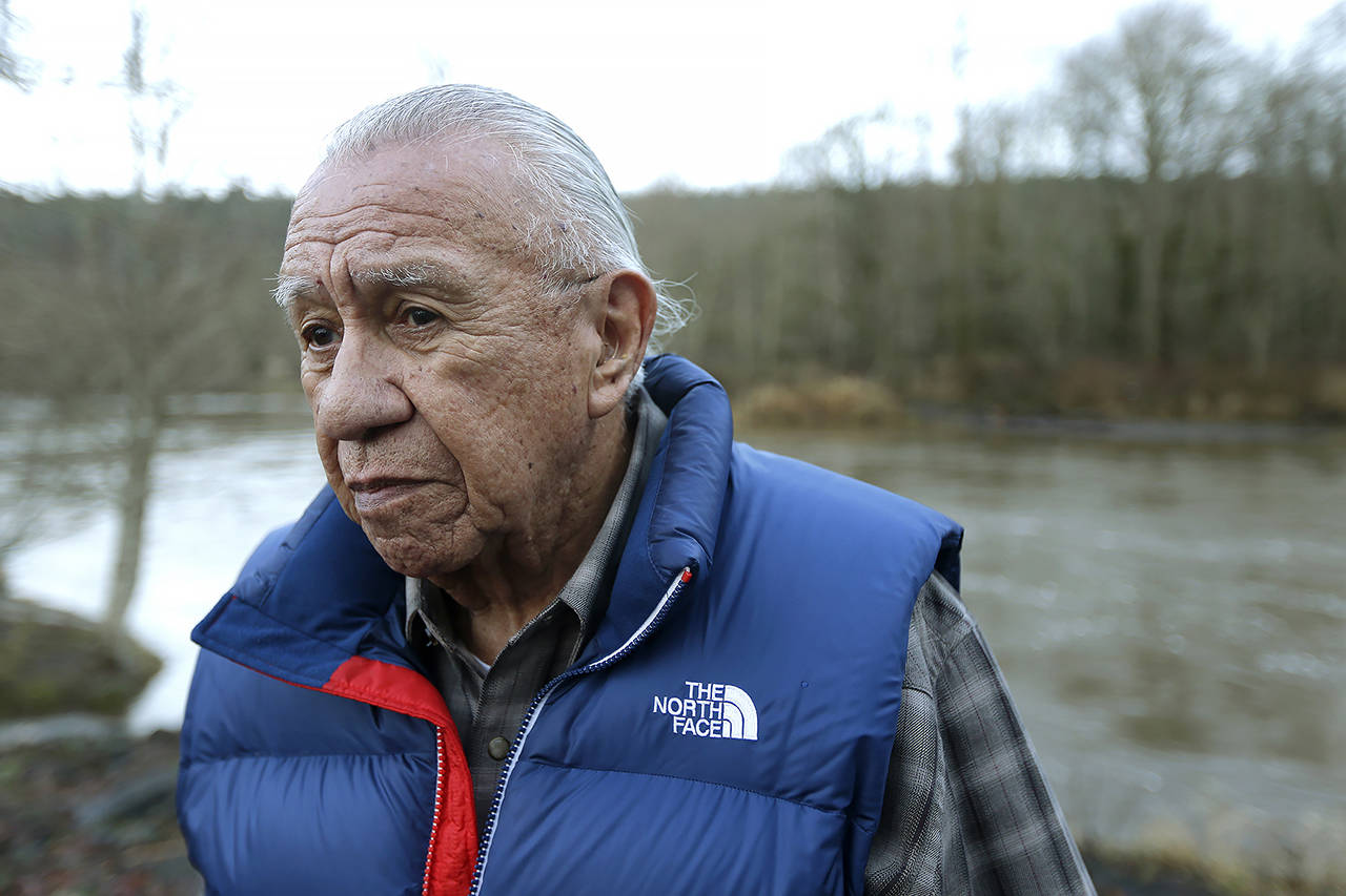 In this Jan. 13, 2014 photo, Billy Frank Jr. poses for a photo near Frank's Landing on the Nisqually River. (AP Photo/Ted S. Warren, File)